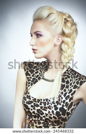 Pretty blonde model in tiger dress