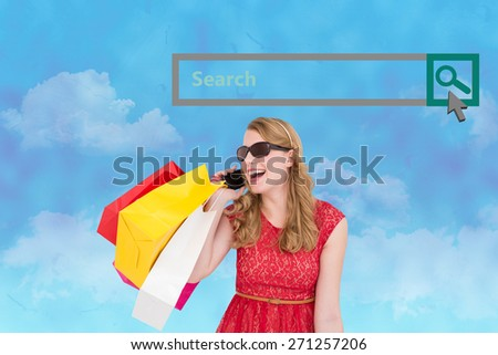 Pretty blonde talking on phone holding shopping bags against painted sky - stock photo