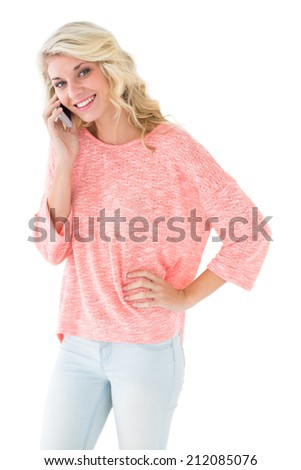 Pretty blonde using her smartphone on white background - stock photo