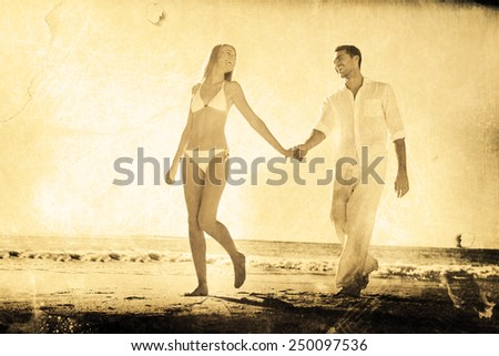 Pretty blonde walking away from man holding her hand against grey background - stock photo