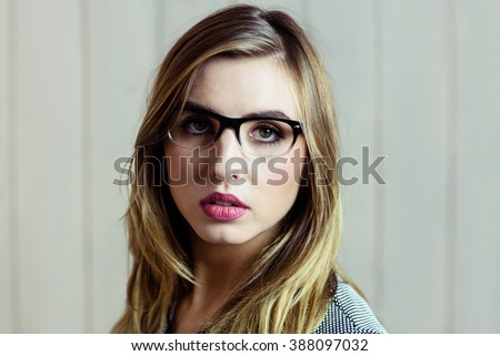 Pretty blonde woman day dreaming on wooden background