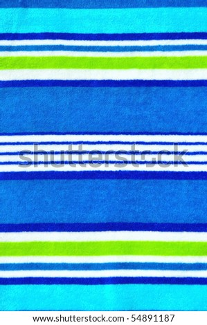 Pretty blue striped beach towel useful as a background pattern