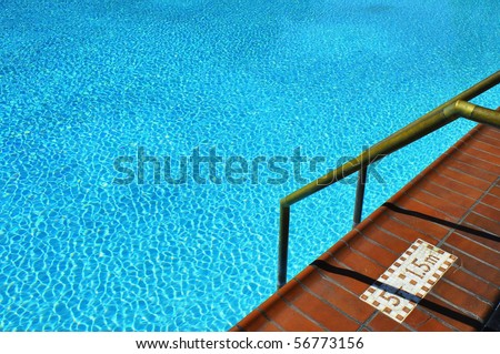 Pretty blue swimming pool, room for your text - stock photo
