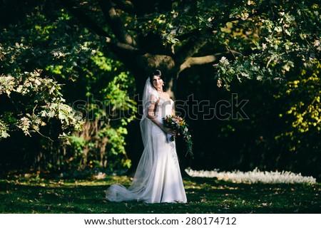 pretty bride in park - stock photo