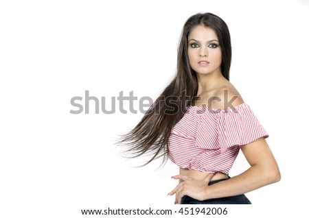 pretty brunette girl turns out to back on a white background