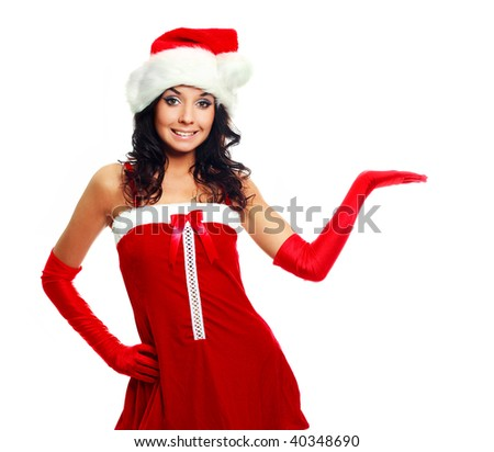 pretty brunette girl with her hand up, place your product here - stock photo