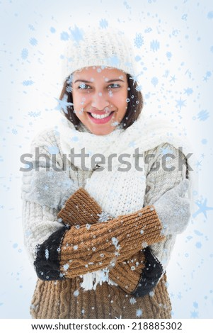 Pretty brunette in warm clothes against snow falling