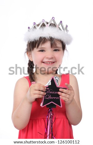 Pretty brunette little girl wearing red dress and crown and holding fairy wand, smiling - stock photo