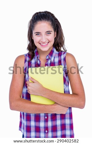 Pretty brunette looking at camera and holding notebook on white background