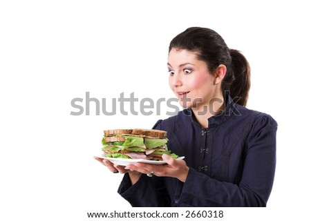 Pretty brunette looking very excited at her sandwich - stock photo