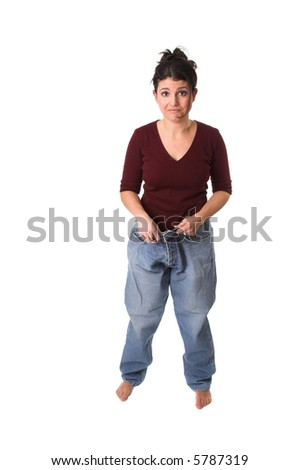 Pretty brunette putting on her jeans after having lost a lot of weight - stock photo