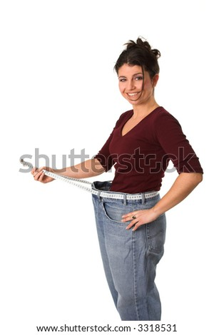 Pretty brunette showing with a measuring tape around her waist how much centimeters she has already lost - stock photo