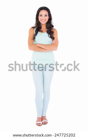 Pretty brunette smiling at camera on white background