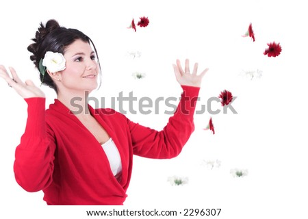 Pretty brunette surrounded by falling flowers in red and white - stock photo