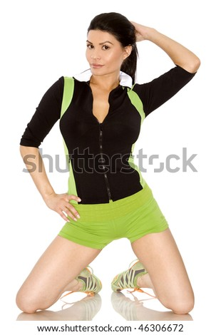 pretty brunette wearing sport outfit on white background - stock photo