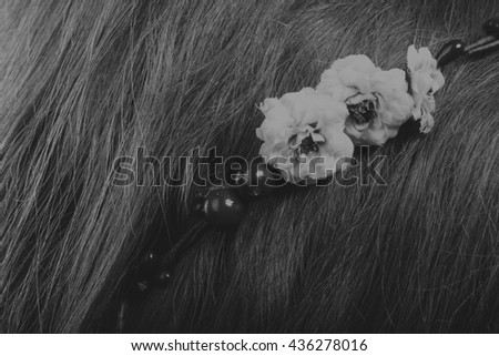 Pretty brunette with a wreath in her hair, black-and-white photo - stock photo