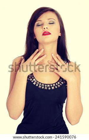 Pretty brunette woman wearing elegant dress. - stock photo
