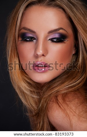pretty brunette woman with asian makeup - stock photo