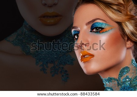 pretty brunette woman with bright creative make up - stock photo