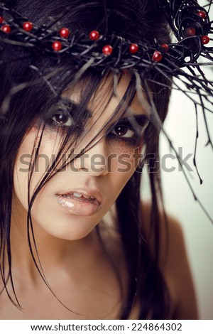 pretty brunette woman with make up like demon at halloween, closeup - stock photo