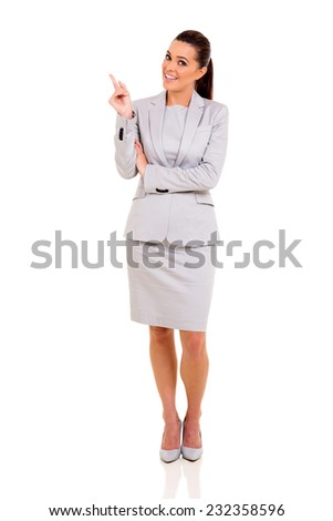 pretty businesswoman pointing empty space on white background - stock photo