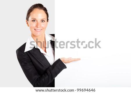 pretty businesswoman presenting white board - stock photo