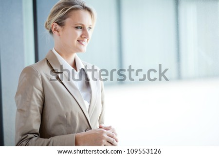 pretty businesswoman standing by office window - stock photo