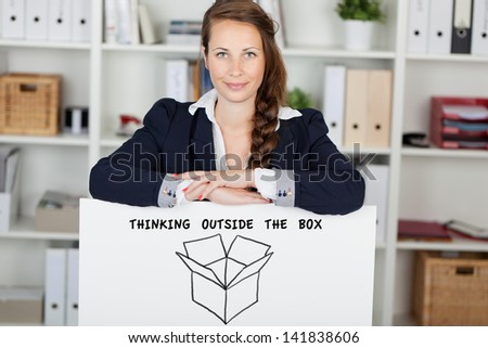 Pretty businesswoman standing with a white board - stock photo