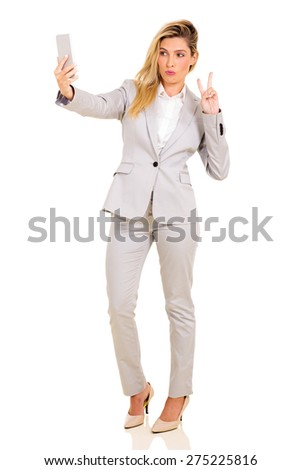 pretty businesswoman taking a selfie with smart phone camera - stock photo