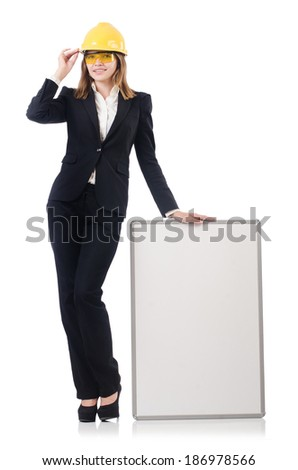 Pretty businesswoman with hard hat and  blank board  isolated on white