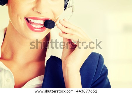 Pretty call-centre assistant smiling at the camera - stock photo