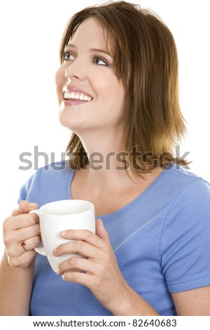 pretty casual brunette wearing blue top holding cup of coffee - stock photo
