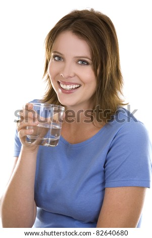 pretty casual brunette wearing blue top holding glass of water - stock photo