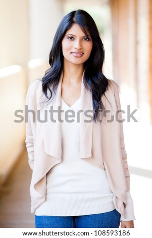 pretty casual young indian woman portrait - stock photo