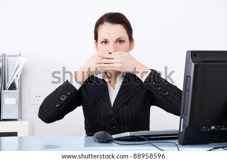 Pretty caucasian businesswoman in the speak no evil pose. - stock photo