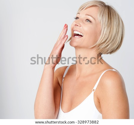 Pretty caucasian lady laughing out loud - stock photo