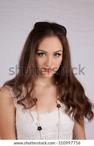Pretty Caucasian woman looking thoughtfully at the camera