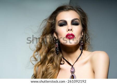 Pretty caucasian woman posing in the studio portrait - stock photo