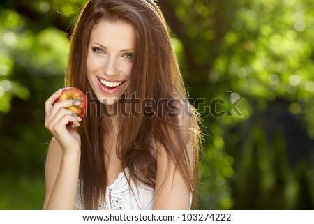 Pretty cheerful woman in the garden - stock photo