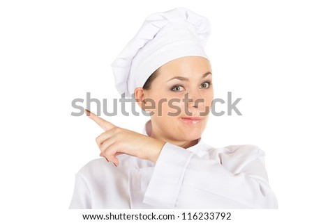 Pretty Chef Cook In Uniform Showing Empty Space By Finger Isolated On White Background (with clipping patch)
