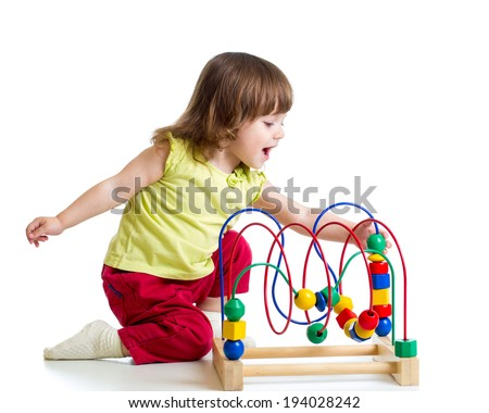 pretty child girl with color educational toy - stock photo