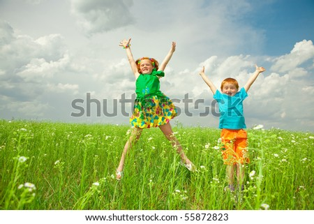 pretty child having fun in the field - stock photo
