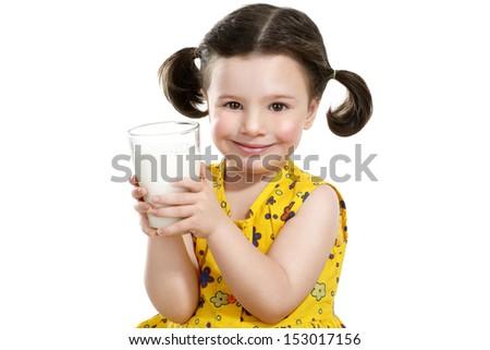 pretty child holding a big glass of milk o white - stock photo