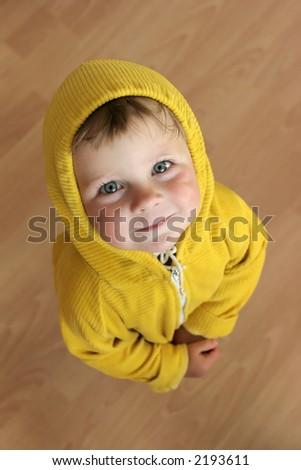 pretty child in yellow looking upward - stock photo