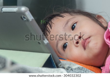 Pretty children looking at laptop - stock photo