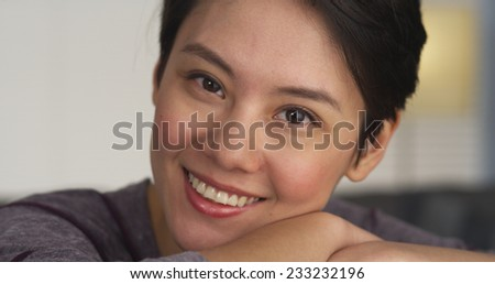 Pretty Chinese woman smiling at camera - stock photo