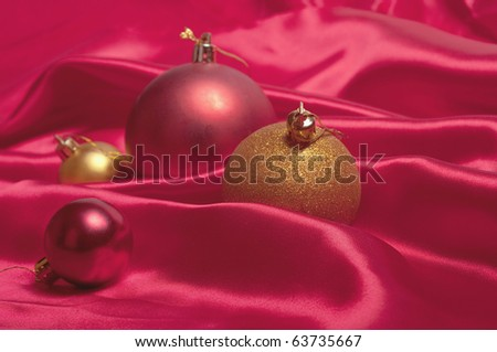 Pretty Christmas baubles with seasonal background