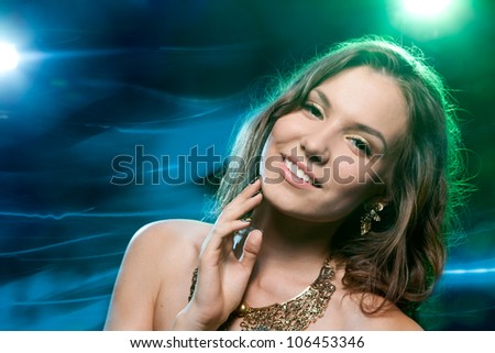 Pretty clubber dancing and looking at camera with smile