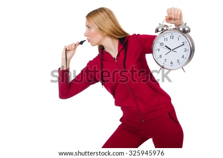 Pretty coach holding alarm clock isolated on white - stock photo