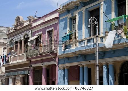 Pretty colored balconies in Havana backstreet - stock photo